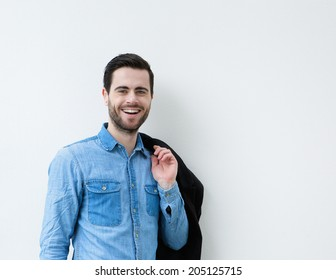 Portrait of a cool young man smiling against white background