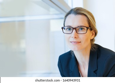 Portrait of corporate woman with eyeglasses