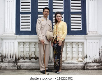 portrait of couple asian smiling with traditional clothing Peranakan dress