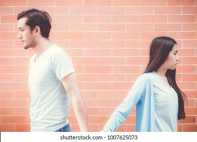 Portrait of couple asian young woman and man outdoor with relationship problem together, emotion unhappy concept.