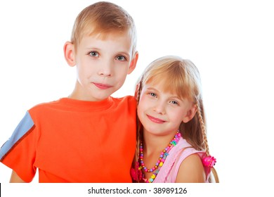 Portrait of couple of children, sister and brother. Shot in a studio.