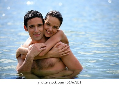 Portrait of a couple embracing in the sea
