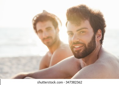Portrait. Couple of friends at sunset on the beach on a day of rest summer vacation together, after spending a day of relaxation and fun