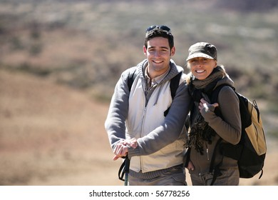Portrait of a couple of hikers smiling