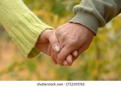 Portrait of a couple holding hands, close up