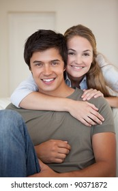 Portrait of a couple hugging in their living room