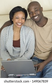 Portrait of couple with laptop