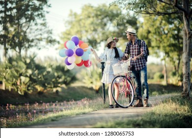 Portrait of a couple in love with balloons colorful
