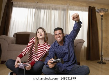 Portrait of couple playing video game