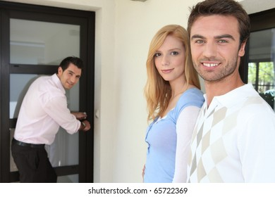 Portrait of a couple with realtor
