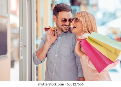 Portrait of a couple with shopping bags.