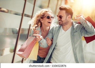 Portrait of a couple with shopping bags in the city.People,sale,love and happiness concept.