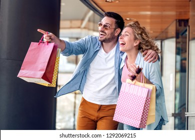Portrait of couple with shopping bags in the city.People,sale,love and happiness concept.