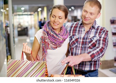 Portrait of couple shopping in the mall