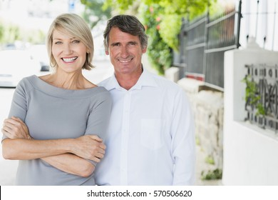 Portrait of couple smiling outdoors in city