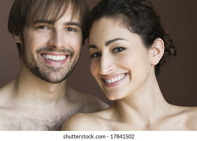 Portrait of couple in studio, smiling