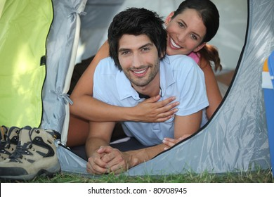 portrait of a couple in a tent