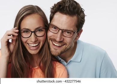 Portrait of couple wearing glasses, studio