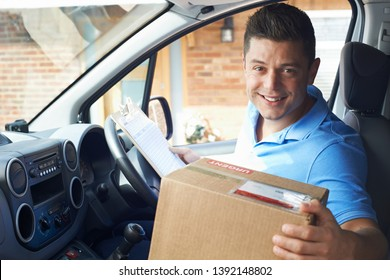 Portrait Of Courier In Van Delivering Package To  House