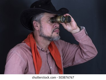 Portrait of a cowboy with binoculars