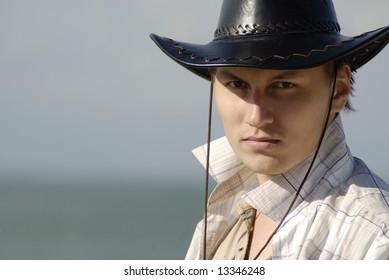 portrait of cowboy with black hat