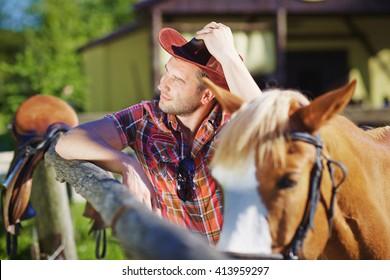 Portrait of a cowboy on the farm