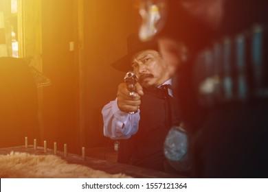 Portrait of a cowboy.Cowboy with revolver.Cowboy gunfight.