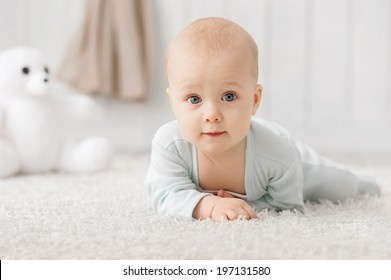 Portrait of a crawling baby on the carpet in my room
