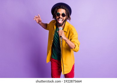 Portrait of crazy funny dark skin person open mouth sing have fun good mood isolated on purple color background