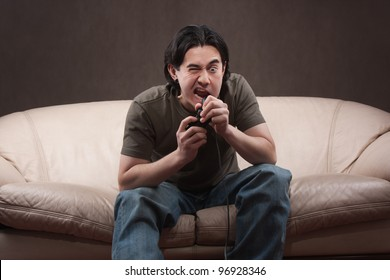 portrait of a crazy gamer on gray background
