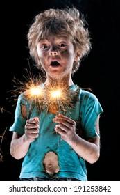 Portrait of crazy little boy over black background
