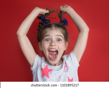 portrait of crazy little girl on red background