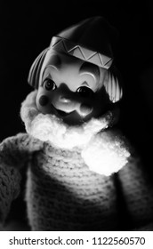 portrait of creepy clown doll smile in black and white and high contrast