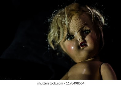 portrait of creepy doll smile in high contrast concept
