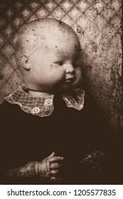 A portrait of a creepy old doll, made to look like a posed baby.