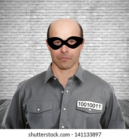 Portrait of a criminal in prison cell on a white background