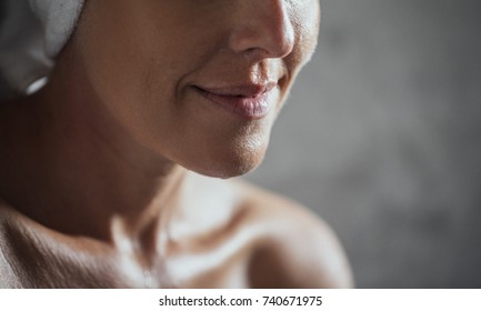 Portrait of cropped unrecognisable woman with towel.