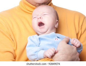 Portrait of crying baby on fathers hands