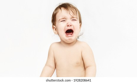 portrait of a crying baby. baby upset. Screaming baby