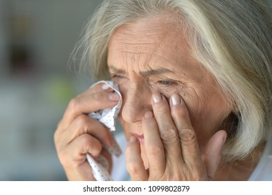 Portrait of  crying Senior woman
