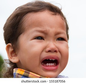 Portrait of crying unhappy little boy outdoor