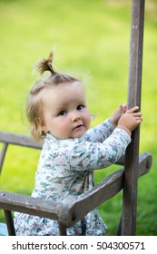 portrait of a curious little girl close-up outdoors