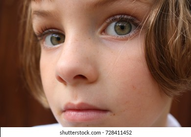 Portrait of a curious yet scared little girl