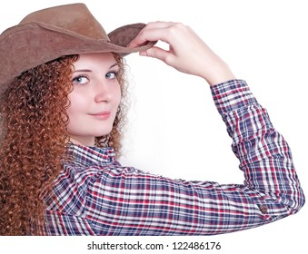 portrait of curly girl in a cowboy hat
