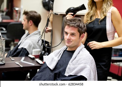 Portrait of a customer with a female hairdresser in a salon