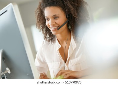 Portrait of customer service assistant talking on phone