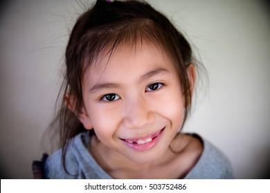 Portrait of cut little girl smiling,Happy girl,Blurry portrait,Asian girl