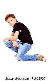 Portrait of a cute 9 year boy sitting on a floor. Isolated over white background.