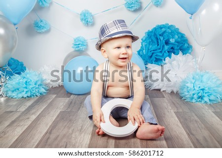 c7b3abab8cf2 Portrait of cute adorable Caucasian baby boy with blue eyes barefoot in  pants with suspenders and