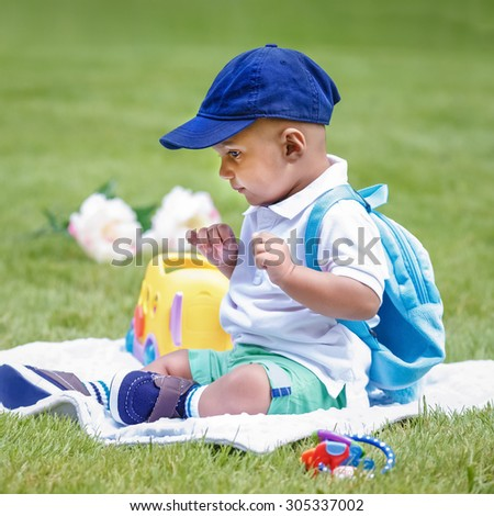 Portrait of cute adorable little indian mixed race infant boy in white  shirt sitting on ground 2bf871c3b19b5